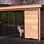 Dog kennel of wood with black pannels