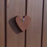 Wooden heart on the door of the chicken coop