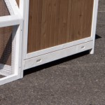 Wooden chicken coop with tray