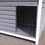 Doghouse with large opening with windbreak