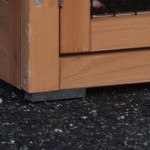 Chicken coop with plastic feet