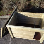 Inside of the doghouse is equipped with a windbreak of wood